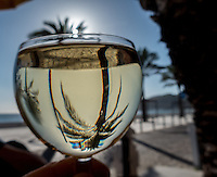 A glass og chilled white wine in the sunset at a pavement cafe in Sismbra, Portugal