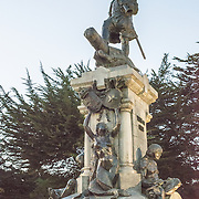 A statue monument dedicated to the first explorer to circumnavigate the glove, Ferdinand Magellan, in the main square of  Punta Arenas, Chile. The city is the largest south of the 46th parallel south and capital city of Chile's southernmost region of Magallanes and Antartica Chilena.