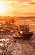 Alaska. Anchorage. Container ship at dockyard at sunset.