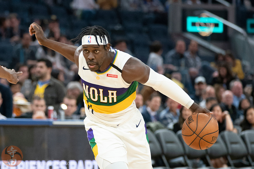 February 23, 2020; San Francisco, California, USA; New Orleans Pelicans guard Jrue Holiday (11) dribbles the basketball during the third quarter against the Golden State Warriors at Chase Center.