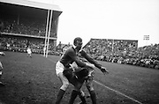 Irelands WR Hunter tackles English left wing, J Roberts, on his own line,..Irish Rugby Football Union, Ireland v England, Five Nations, Landsdowne Road, Dublin, Ireland, Saturday 9th February, 1963,.9.2.1963, 2.9.1963,..Referee- H B Laidlaw, Scottish Rugby Union, ..Score- Ireland 0 - 0 England, ..Irish Team, ..B D E Marshall, Wearing number 15 Irish jersey, Full Back, Queens University Rugby Football Club, Belfast, Northern Ireland,..W R Hunter, Wearing number 14 Irish jersey, Right Wing, C I Y M S Rugby Football Club, Belfast, Northern Ireland, ..J C Walsh,  Wearing number 13 Irish jersey, Right Centre, University college Cork Football Club, Cork, Ireland,..P J Casey, Wearing number 12 Irish jersey, Left Centre, University College Dublin Rugby Football Club, Dublin, Ireland, ..N H Brophy, Wearing number 11 Irish jersey, Left wing, Blackrock College Rugby Football Club, Dublin, Ireland, ..M A English, Wearing number 10 Irish jersey, Stand Off, Landsdowne Rugby Football Club, Dublin, Ireland, ..J C Kelly, Wearing number 9 Irish jersey, Scrum Half, University College Dublin Rugby Football Club, Dublin, Ireland,..R J McLoughlin, Wearing number 1 Irish jersey, Forward, Blackrock College Rugby Football Club, Dublin, Ireland, ..A R Dawson, Wearing number 2 Irish jersey, Forward, Wanderers Rugby Football Club, Dublin, Ireland, ..S Millar, Wearing number 3 Irish jersey, Forward, Ballymena Rugby Football Club, Antrim, Northern Ireland,..W A Mulcahy, Wearing number 5 Irish jersey, Captain of the Irish team, Forward, Bective Rangers Rugby Football Club, Dublin, Ireland,  ..W J McBride, Wearing number 5 Irish jersey, Forward, Ballymena Rugby Football Club, Antrim, Northern Ireland,..E P McGuire, Wearing number 6 Irish jersey, Forward, University college Galway Football Club, Galway, Ireland,..C J Dick, Wearing number 8 Irish jersey, Forward, Ballymena Rugby Football Club, Antrim, Northern Ireland,..M D Kiely, Wearing number 7 Irish jersey, Forward, Landsdowne Rugby Football Clu