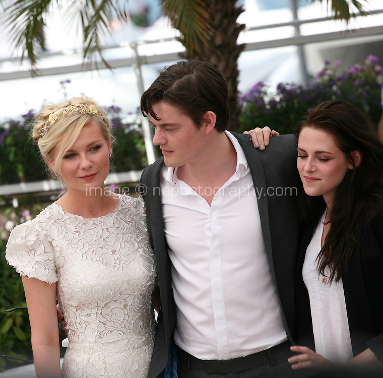 Kirsten Dunst, Sam Riley, Kristen Stewart, at the On The Road photocall at the 65th Cannes Film Festival France. The film is based on the book of the same name by beat writer Jack Kerouak and directed by Walter Salles. Wednesday 23rd May 2012 in Cannes Film Festival, France.