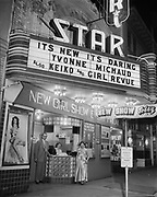 """Y-540416-2. """"Keiko (dancer) & theatre manager for Mossman April 16, 1954"""" Star Theatre Marquee. NW 6th between Burnside & Couch."""