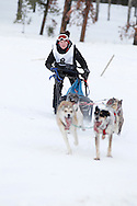 Photo Randy Vanderveen.Grande Prairie , Alberta.13-01-05.Rachel Kinvig urges her dog team through the race course as she takes part in the Four Dog -4 Mile event. The Grande Prairie Sled Dog Derby ran two days of races at Evergreen Park this past weekend, Jan. 5 and 6.