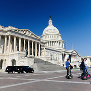 A group of tourists on Segways in the piazza outside the US Capitol Building in Washington DC