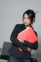 cute funny young expressive women asian working woman at the office