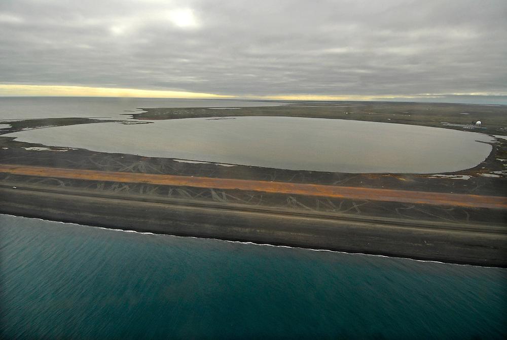 Alaska, Barrow. Aerial view of Elson Lagoon, NARL runway and shore of the Arctic Ocean. July 2007