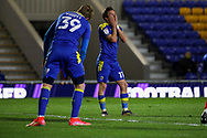 AFC Wimbledon midfielder Ethan Chislett (11) with head in hands after shooting over the bar during the EFL Sky Bet League 1 match between AFC Wimbledon and Gillingham at Plough Lane, London, United Kingdom on 23 February 2021.