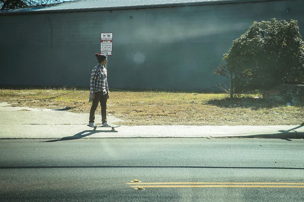 A skater makes his way downtown in San Antonio, TX