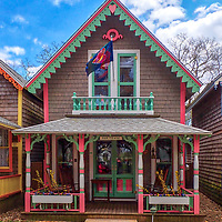 New England photography of the adorable Gingerbread houses in Oak Bluffs on Martha's Vineyard, Massachusetts.<br /> <br /> Martha's Vineyard Gingerbread houses photography images are available as museum quality photography prints, canvas prints, acrylic prints, wood prints or metal prints. Fine art prints may be framed and matted to the individual liking and decorating needs:<br /> <br /> https://juergen-roth.pixels.com/featured/whimsical-gingerbread-house-of-marthas-vineyard-juergen-roth.html<br /> <br /> Good light and happy photo making!<br /> <br /> My best,<br /> <br /> Juergen