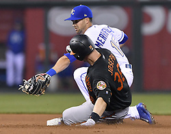 May 12, 2017 - Kansas City, MO, USA - Baltimore Orioles' Caleb Joseph reaches second before the tag from Kansas City Royals second baseman Whit Merrifield on a double in the seventh inning on Friday, May 12, 2017 at Kauffman Stadium in Kansas City, Mo. (Credit Image: © John Sleezer/TNS via ZUMA Wire)
