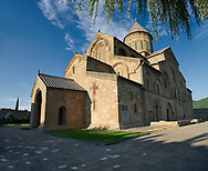 Pictures & images of the exterior of the Eastern Orthodox Georgian Svetitskhoveli Cathedral (Cathedral of the Living Pillar) , Mtskheta, Georgia (country). A UNESCO World Heritage Site.<br /> <br /> Currently the second largest church building in Georgia, Svetitskhoveli Cathedral is a masterpiece of Early Medieval architecture completed in 1029 by Georgian architect Arsukisdze on an earlier site dating back toi the 4th century. .<br /> <br /> Visit our MEDIEVAL PHOTO COLLECTIONS for more   photos  to download or buy as prints https://funkystock.photoshelter.com/gallery-collection/Medieval-Middle-Ages-Historic-Places-Arcaeological-Sites-Pictures-Images-of/C0000B5ZA54_WD0s<br /> <br /> Visit our REPUBLIC of GEORGIA HISTORIC PLACES PHOTO COLLECTIONS for more photos to browse, download or buy as wall art prints https://funkystock.photoshelter.com/gallery-collection/Pictures-Images-of-Georgia-Country-Historic-Landmark-Places-Museum-Antiquities/C0000c1oD9eVkh9c