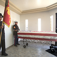Gunnery Sergeant Perry James (left), honorary Navajo Code Talker and 2 members of the United States Marine Corp Honor Guard stand watch over the casket of Navajo Code Talker Fleming D. Begaye, Sr. Friday morning at funeral services held in Chinle, Arizona.