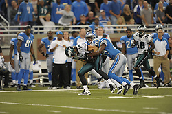DETROIT - SEPTEMBER 19: Wide Receiver Riley Cooper #14 of the Philadelphia Eagles is tackled during the game against the Detroit Lions on September 19, 2010 at Ford Field in Detroit, Michigan. (Photo by Drew Hallowell/Getty Images)  *** Local Caption *** Riley Cooper