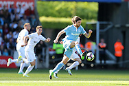 Joe Allen of Stoke city in action..  Premier league match, Swansea city v Stoke City at the Liberty Stadium in Swansea, South Wales on Saturday 22nd April 2017.<br /> pic by Andrew Orchard, Andrew Orchard sports photography.