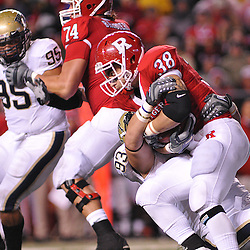 Oct 16, 2009; Piscataway, NJ, USA; Pittsburgh defensive tackle Gus Mustakas (93) tackles Rutgers running back Joe Martinek (38) during second half NCAA football action in Pittsburgh's 24-17 victory over Rutgers at Rutgers Stadium.