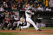 CHICAGO - OCTOBER 23:  Scott Podsednik #22 of the Chicago White Sox hits a game winning, walk off home run off Brad Lidge in the bottom of the ninth inning during Game 2 of the 2005 World Series against the Houston Astros at US Cellular Field on October 23, 2005 in Chicago, Illinois.  The team mobbed Podsednik as he crossed home plate.  The White Sox defeated the Astros 7-6.
