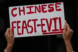 London, Jene 26th 2015. Scores of animal lovers descend on the Chinese embassy to protest against the Yulin Dog Meat Festival where thousands of dogs, often killed using extremely cruel methods, are eaten. According to one anti-cruelty activist, the Yulin festival is only 10 years old and is a possible backlash against the anti-dog meat crusade from the west.