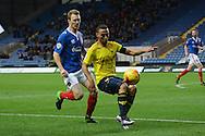 Oxford United midfielder Kemar Roofe holds the ball up watched by Carlisle United midfielder Antony Sweeney during the Sky Bet League 2 match between Oxford United and Carlisle United at the Kassam Stadium, Oxford, England on 12 December 2015. Photo by Alan Franklin.