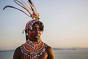 A Samburu warrior standing on a hilltop overlooking Lake Turkana, Lake Turkana, Loiyangalani,Kenya, Africa