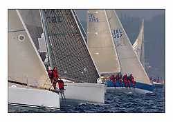 Racing at the Bell Lawrie Yachting Series in Tarbert Loch Fyne. Saturday racing started overcast but lifted throughout the day...The bow of Antix moves over IRL3671 Galileo and the IMX IRL2382 Xerxes. The Irish won the nations event clearly this year..