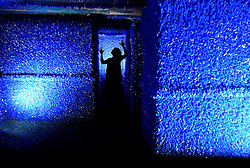 """© Licensed to London News Pictures. 13/06/2013. Wakefield, UK A woman inside the artwork at The Yorkshire Sculpture Park today 13th June 2013. Roger Hiorns' work """"Seizure"""" originally a flat on a condemned London council estate whose every surface he encrusted in a thick, Yves Klein-blue carapace of copper sulphate crystals, has been removed from south London and, from 15th June, will go on public display at the Yorkshire Sculpture Park. Photo credit : Nigel Roddis/LNP"""
