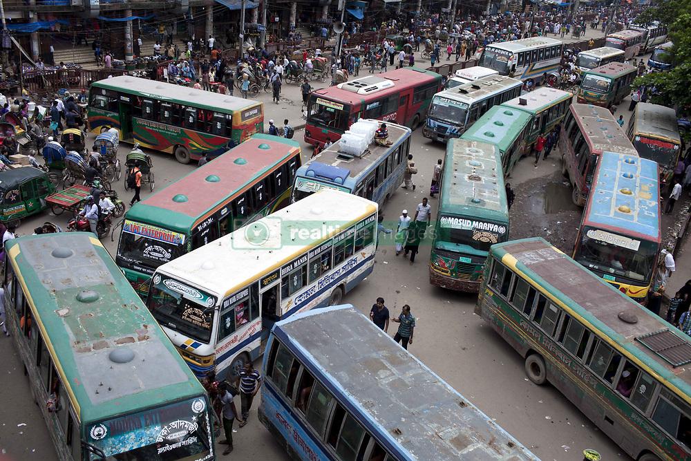 July 23, 2017 - Dhaka, Dhaka, Bangladesh - Hazardous road crossing made traffic jam in Dhaka, Bangladesh on July 23, 2017. Dhaka last 10 years, average traffic speed has dropped from 21 km/hour to 7 km/hour, only slightly above the average walking speed. Congestion in Dhaka eats up 3.2 million working hours per day, according to the World Bank. (Credit Image: © Km Asad/NurPhoto via ZUMA Press)