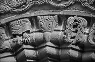 The Stone Bestiary - Black and white photo art print of Norman Romanesque relief sculptures of dragons and mythical creatures depicting the struggle between good and evil, from the South doorway of Church of St Mary and St David, Kilpeck Herifordshire, England. Built around 1140 .<br /> <br /> Visit our LANDSCAPE PHOTO ART PRINT COLLECTIONS for more wall art photos to browse https://funkystock.photoshelter.com/gallery-collection/Places-Landscape-Photo-art-Prints-by-Photographer-Paul-Williams/C00001WetsxVxNTo .<br /> <br /> By Photographer Paul E Williams