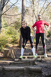 Couple relaxing while training on obstacle course in nature