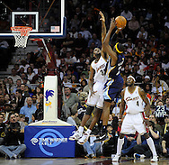 Joe Smith of Cleveland goes up to defend a shot by Hakim Warrick of Memphis while Ben Wallace watches.
