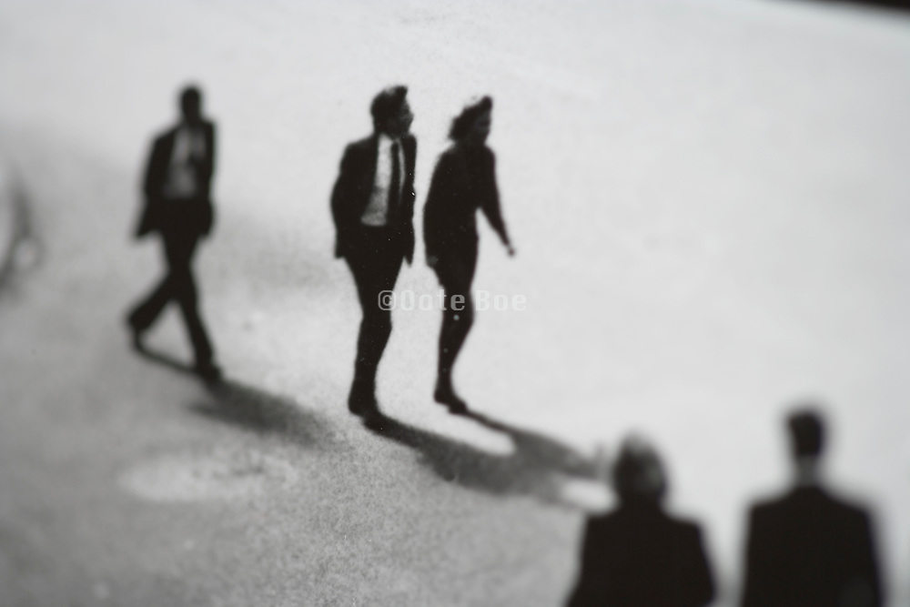 group of business people walking downtown New York city