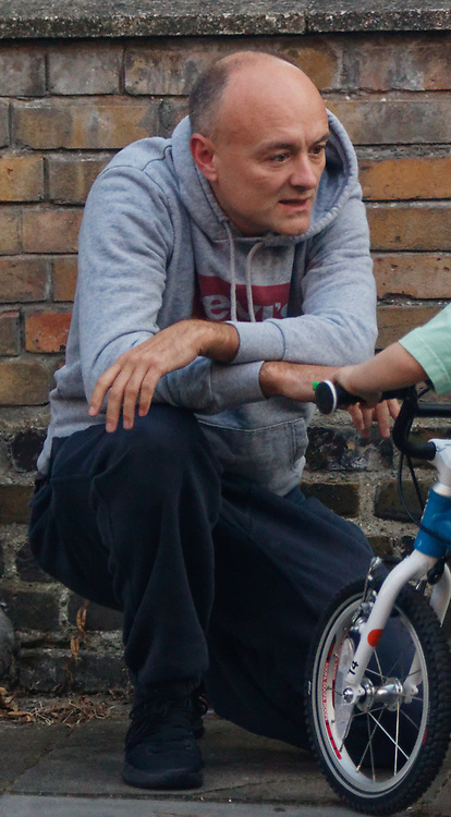 PICTURE EXCLUSIVE - SPECIAL FEES APPLY - CALL BEFORE USE<br /> London, United Kingdom - 8 September 2019<br /> Dominic Cummings looks startled to be spotted arriving back at his north London home on Sunday after a day out with his wife, Mary Wakefield, his son and some friends. Despite clutching a new child's bicycle and fussing over his young son, at times he seemed lost in his thoughts as he tried to focus on his family rather than the dramatic and explosive week in Westminster politics. As Boris Johnson's special political advisor, the former campaign director of Vote Leave has this week found himself at the centre of controversy and harsh criticism from MPs over the handling of the sacking of twenty one rebel Conservative MPs.<br /> EXCLUSIVE PICTURES - MANDATORY BYLINE: EQUINOXFEATURES.COM - A charge is made for each use of each picture in each format on each platform in each territory.<br /> (photo by: EQUINOXFEATURES.COM)<br /> Picture Data:<br /> Photographer: Equinox Features<br /> Copyright: ©2019 Equinox Licensing Ltd. +443700 780000<br /> Contact: Equinox Features<br /> Date Taken: 20190908<br /> Time Taken: 18473207<br /> www.newspics.com
