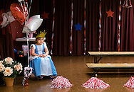 """11 APRIL 2016 -- ST. LOUIS -- Nora Massaro, a student at Sacred Heart Villa preschool in The Hill neighborhood of St. Louis, prepares to serve at """"Queen of Opening Day"""" during a celebration marking the St. Louis Cardinals first home game of the 2016 baseball season Monday, April 11, 2016. Photo © copyright 2016 Sid Hastings."""
