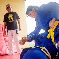 Amy Mitchell spars with her brother under the coaching of their father Michael Mitchell at their home in Tohatchi Tuesday.