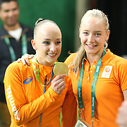 Gymnastics - Olympics: Day 10  Gold medal winner Sanne Wevers, (left), of The Netherlands with her twin sister Lieke Wevers after winning the gold medal in the Women's Balance Beam Final during the Artistic Gymnastics competition at the Rio Olympic Arena on August 15, 2016 in Rio de Janeiro, Brazil. (Photo by Tim Clayton/Corbis via Getty Images)