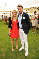 EDWARD & CHRISTABEL LAWSON-JOHNSTON at the Cartier International Polo at Guards Polo Club, Windsor Great Park, Berkshire on 25th July 2010.