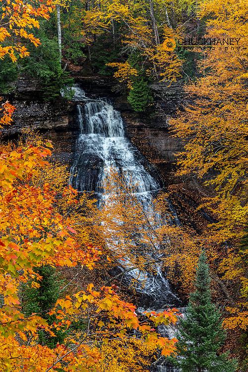 Brilliant Fall color frames Chapel Falls at Pictured Rocks National Lakeshore, Michigan, USA