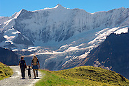 Grindelwald First- Family Walking  - Grindelwald First- Swiss Alps, Switzerland .<br /> <br /> Visit our SWITZERLAND  & ALPS PHOTO COLLECTIONS for more  photos  to browse of  download or buy as prints https://funkystock.photoshelter.com/gallery-collection/Pictures-Images-of-Switzerland-Photos-of-Swiss-Alps-Landmark-Sites/C0000DPgRJMSrQ3U