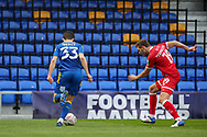 AFC Wimbledon midfielder Callum Reilly (33) dribbling in front of safe standing stand during the The FA Cup match between AFC Wimbledon and Crawley Town at Plough Lane, London, United Kingdom on 29 November 2020.