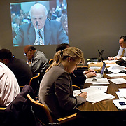 "Press room during the hearing. A live feed of the hearing was projected on the wall. Commission staffers present Staff Statement No. 15, ""Overview of the Enemy."" The 9/11 Commission's 12th public hearing on ""The 9/11 Plot"" and ""National Crisis Management"" was held June 16-17, 2004, in Washington, DC."