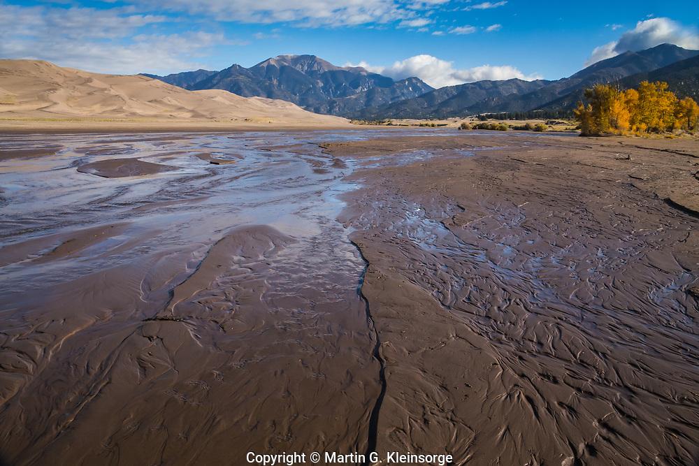 Medano Creek flows seasonally around the dunefield.  The creek orginates in the Sangre De Cristo Mountains and carries precious moisture to the desert San Luis Valley.  Great Sandunes National Park and Preserve, Colorado, USA.