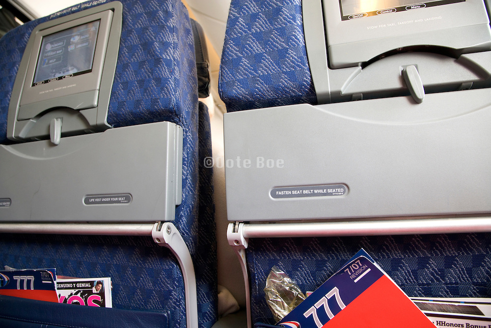 back of passenger seats inside an American Airlines airplane in the coach class