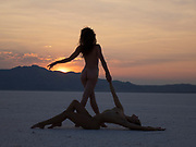 Two nude women posing at sunset at the Bonneville Salt Flats, Utah