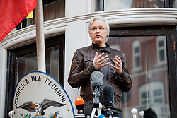 © Licensed to London News Pictures. 19/05/2017. London, UK. Wikileaks founder JULIAN ASSANGE speaks on the balcony of Ecuadorian embassy in London where he has been living since 2012. Today the Swedish authorities have announced that they are dropping their investigation into rape allegations against him. Photo credit: Tolga Akmen/LNP