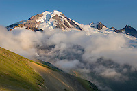 Clouds dissipating in the evening around Mount Baker (elevation 10,778feet (3,285m). Seen from Chowder Ridge, Mount Baker Wilderness Washington USA