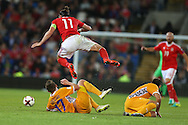 Gareth Bale of Wales is sent flying in a tackle. Wales v Moldova , FIFA World Cup qualifier at the Cardiff city Stadium in Cardiff on Monday 5th Sept 2016. pic by Andrew Orchard, Andrew Orchard sports photography