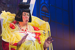 """© Licensed to London News Pictures. 05/12/2013. London, England. Picture: Matthew Kelly as Widow Twankey. The Panto Aladdin starring Jo Brand as the Genie of the Ring and Matthew Kelly as Widow Twankey opens at the New Wimbledon Theatre, Wimbledon, London. From 6 December 2013 to 10 January 2014. Further actors: the dance group """"Flawless"""" as the Peking Police Force, Oliver Thornton as Aladdin, David Bedella as Abanazar, Claire-Marie Hall as Princess Jasmine. Photo credit: Bettina Strenske/LNP"""