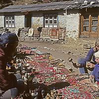 NEPAL, HIMALAYA. Trekking mother & son (MR) shop for artifacts beside Mt. Everest Base Camp trail, Sagarmatha Nat. Park.