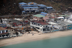 Aerial view of the houses destroyed by Irma during the visit of France's President Emmanuel Macron in the French Caribbean islands of St. Martin, Tuesday, Sept. 12, 2017. Macron is in the French-Dutch island of St. Martin, where 10 people were killed on the French side and four on the Dutch. Photo by Christophe Ena/Pool/ABACAPRESS.COM