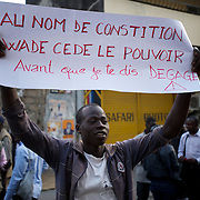 February 23, 2012 - Dakar, Senegal: A opposition supporter holds a poster during a protest against the candidature of the current president Abdoulaye Wade for a anti-constitutional third candidature to as head of state. Tensions between police and opposition supporters have been high in the capital Dakar and other cities around the country, where some clashes have happen ahead of the presidential elections on the 26th of February. At least fourteen people have died in the past month. (Paulo Nunes dos Santos/Polaris)